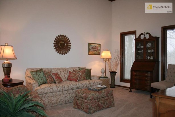 Your formal living room offers a vaulted ceiiling (photo 3)