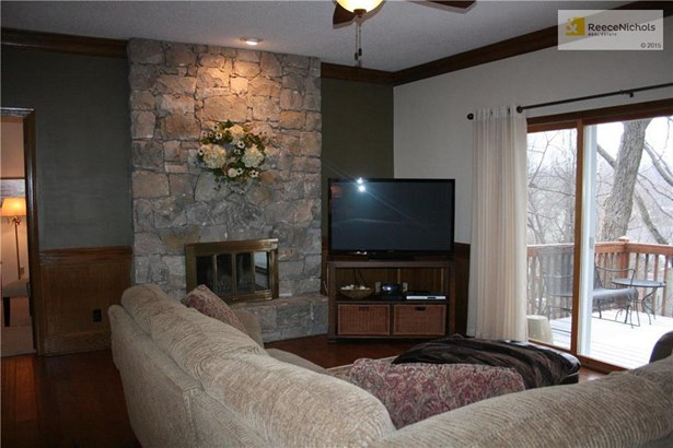 The entire first floor has new hardwood floors.  The hand stacked fireplace is the vocal point of your family room.  Enjoy the view of your wooded backyard. (photo 5)
