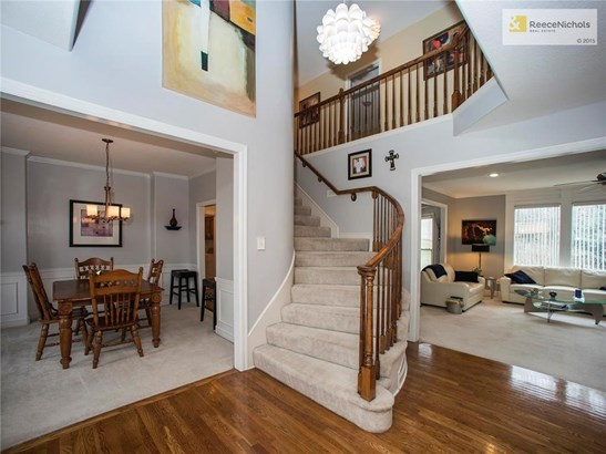 WELCOME - an entry that makes a statement - curved staircase - entry to formal dining and living rooms....... (photo 4)