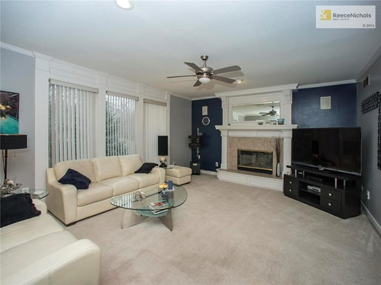 Living Room with fireplace, crown molding and views to the backyard.  Traditional with a modern twist. (photo 5)