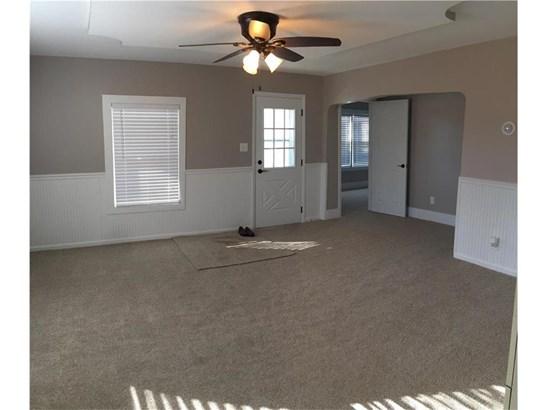 Living room with front door and bedroom door in back. (photo 3)