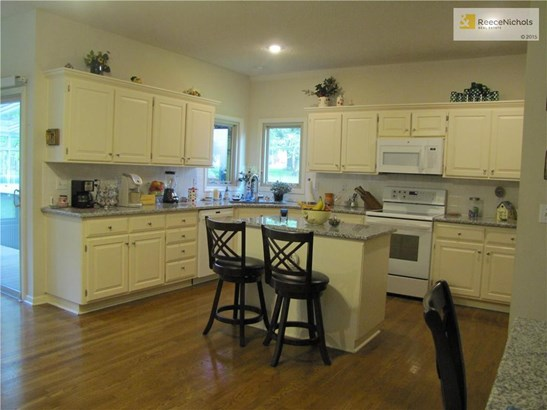 Newer Granite counters and great breakfast island (photo 3)