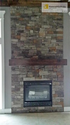Beautiful stone gas log fireplace in great room. (photo 4)