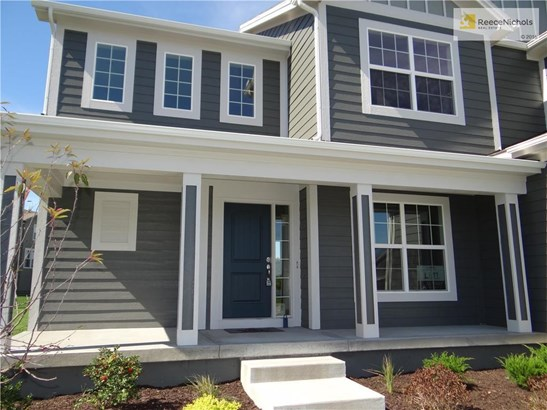 Enjoy a covered front porch at the entrance of this home. (photo 2)