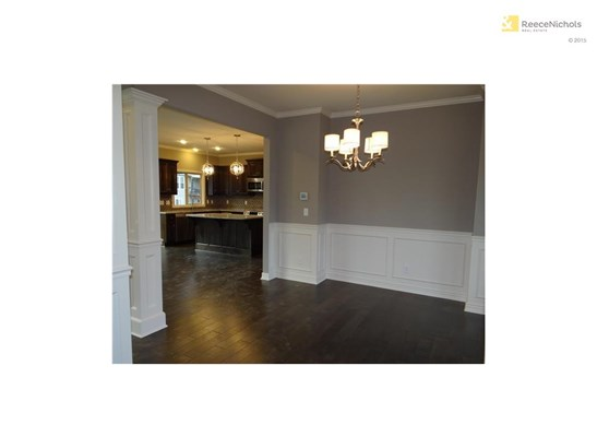 Hardwood floors throughout the front entrance, formal dining room, breakfast nook and kitchen. (photo 3)