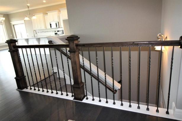 Custom Woodwork on Stairwell near Entry (photo 3)