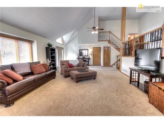 Open & Bright w/vaulted ceilings, newer carpeting, iron spindles and custom blinds (photo 2)