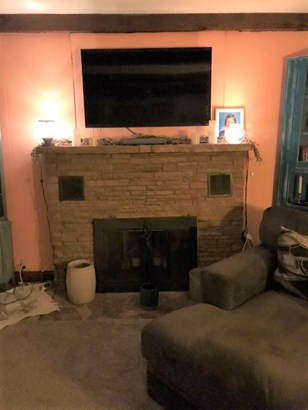 Fireplace in living room (photo 4)