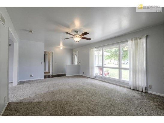 Entry with wood flooring opens to large, bright living room. (photo 4)