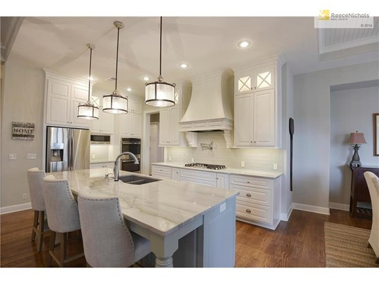 Gourmet kitchen w/ exotic granite, upgraded sink, plumbing & upgraded cabinets w/ soft close feature. (photo 3)