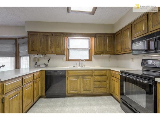 Plenty of counter space in the kitchen with beautiful wood cabinets. (photo 4)