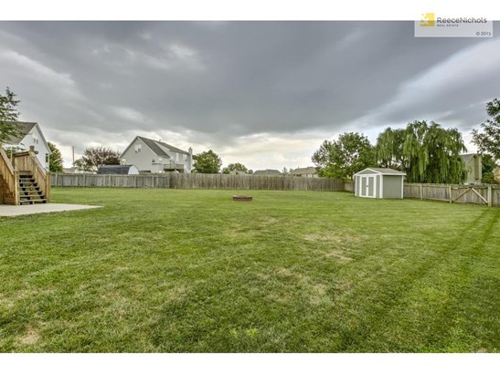 Very spacious fully fenced lot with shed and fire pit (photo 5)
