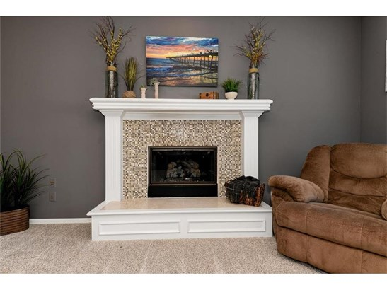 The Gas Fireplace is surrounded with ceramic tile. (photo 5)