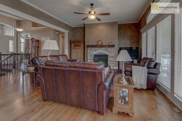 Stone fireplace and extensive upgraded trim throughout. (photo 4)