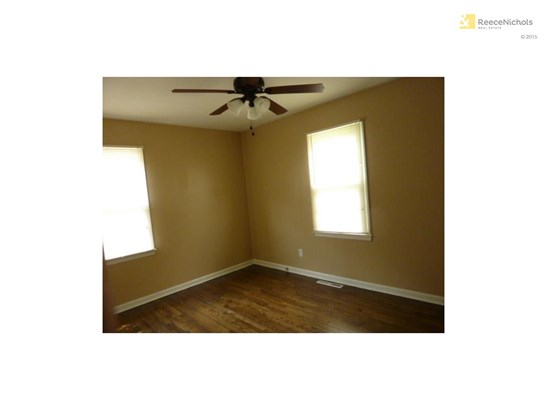 Bedroom 1 with wood floors (photo 4)