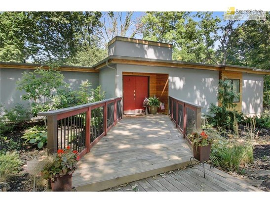 This modern, newly remodeled Reverse 1.5 story/Raised Ranch is situated on a beautifully landscaped lot (photo 1)