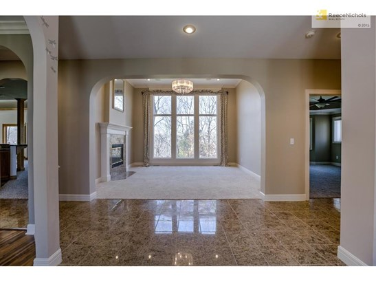 Granite tile entry leads to formal living room with see through fireplace (photo 4)