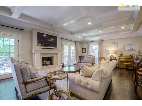 Incredible great room with recessed LED lighting, rebuilt fireplace, and smart TV and soundbar that STAY with the home! (photo 4)