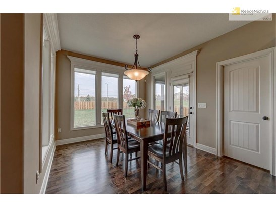 Breakfast nook surrounded by windows (photo 5)