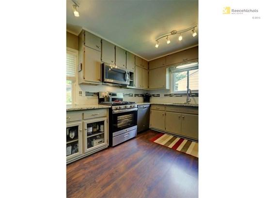 New tile, floor, lights, appliances, windows & painted cabinets (photo 2)