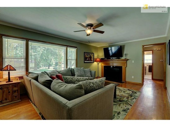 Spacious living room with large new windows, new ventless gas fireplace w/remote control, fresh paint & new ceiling fan (photo 3)