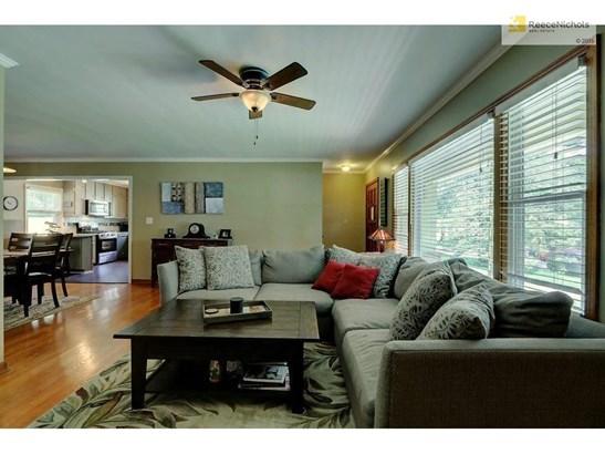 Open floor plan connecting kitchen, dining room & living room (photo 4)