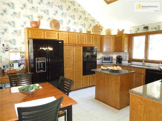 Bright kitchen with large skylight and center island. (photo 5)