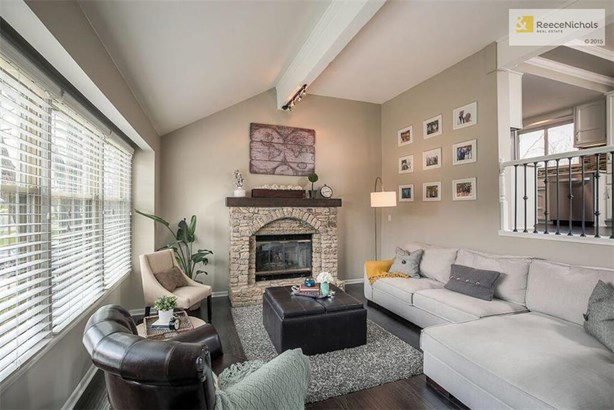 Warm and Inviting Family Room with Beautiful Stone Fireplace. (photo 2)