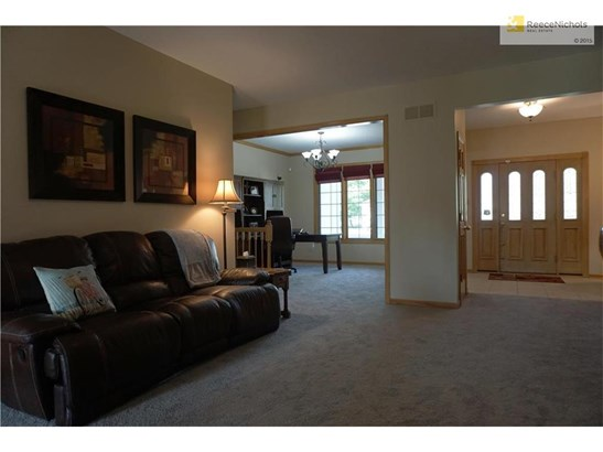 This open floor plan has easy access to the formal dining room, currently utilized as the family office. (photo 4)