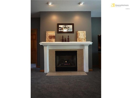 A dramatic fireplace is the focal point of the great room! (photo 5)