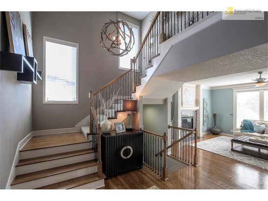 Wood stairs designer colors and lighting fixtures throughout (photo 2)