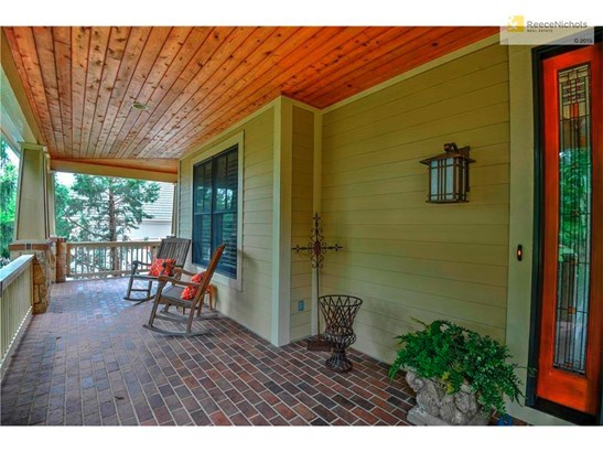 Fabulous covered front porch w/ brick floor and wood ceiling. (photo 4)