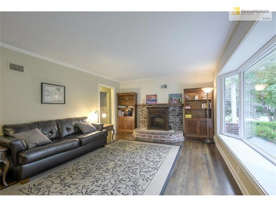 Spacious living room with gleaming hardwoods and natural light. (photo 2)