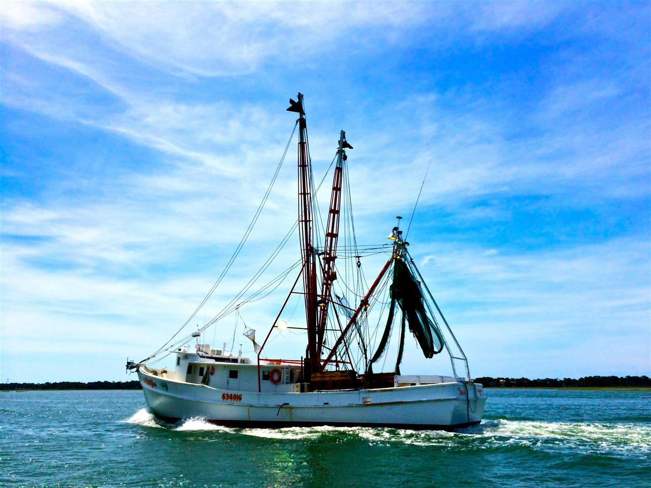 Shrimp boat leaving for a day on the water, Swansboro, NC