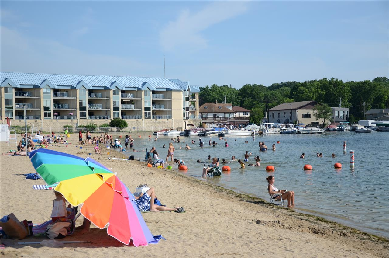 Lakefont Park Pewaukee, WI. Great sandy beach in Downtown Pewaukee. Watch the fireworks, enjoy the beach!