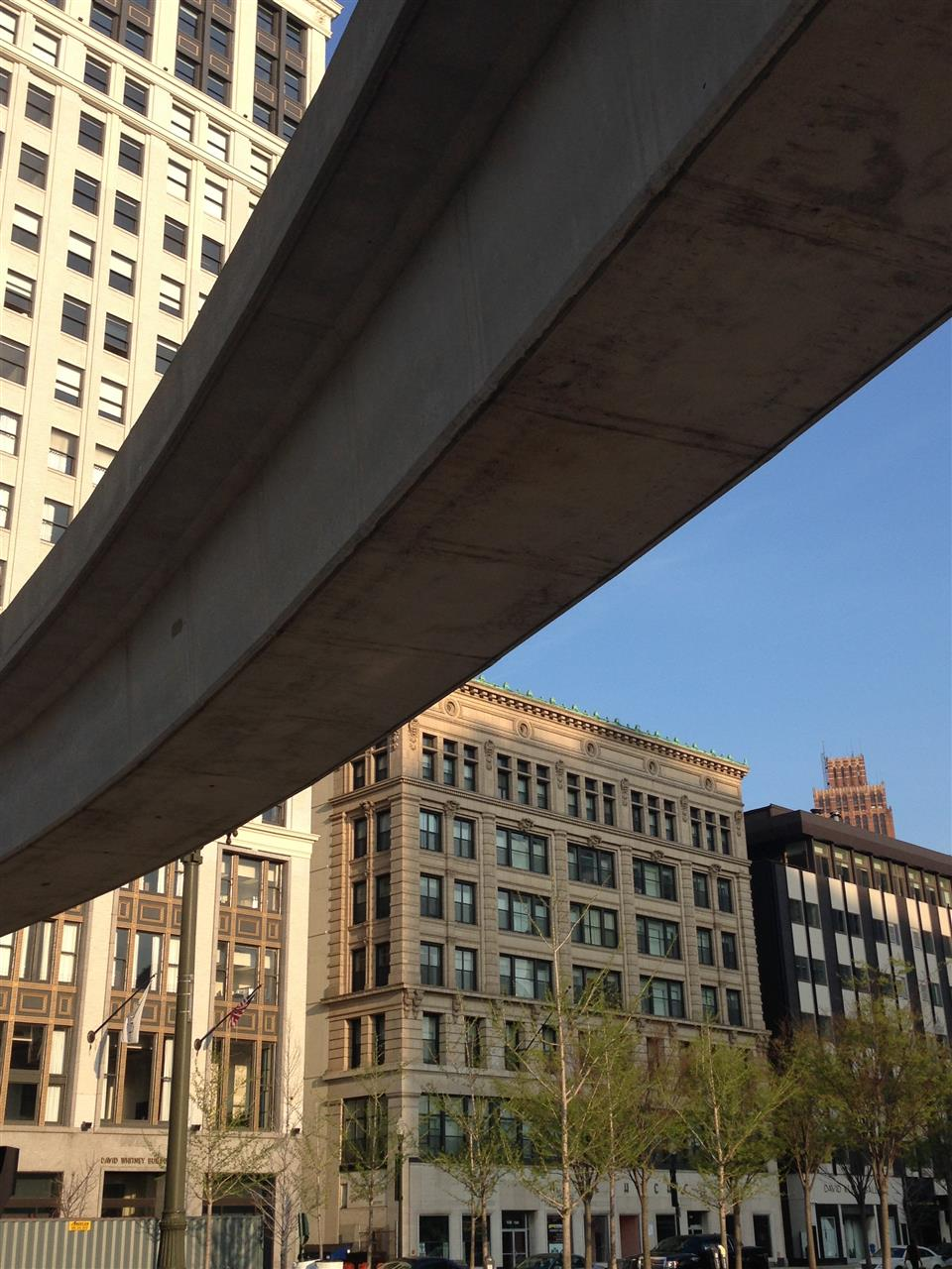 People Mover rail and downtown buildings. The People Mover is an automated guideway transportation system that circulates around downtown Detroit. ~ Detroit, Michigan #LeadingRElocal #Detroit #Michigan