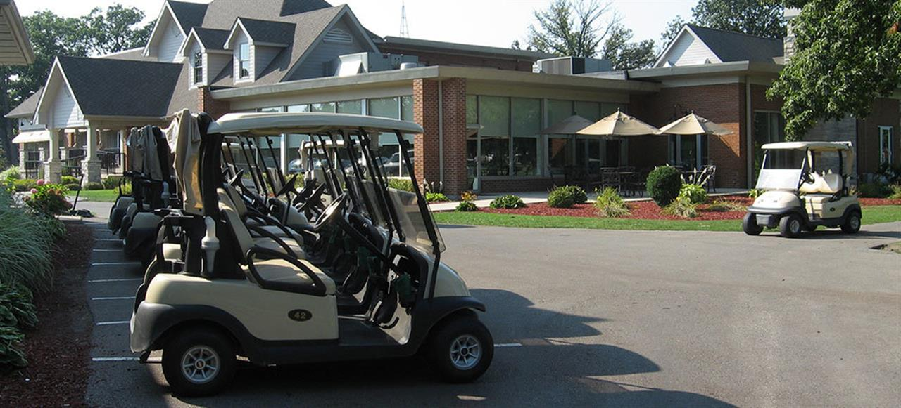 Golf carts parked beside the Pro Shop at Innsbrook Country Club in Merrillville, Indiana.