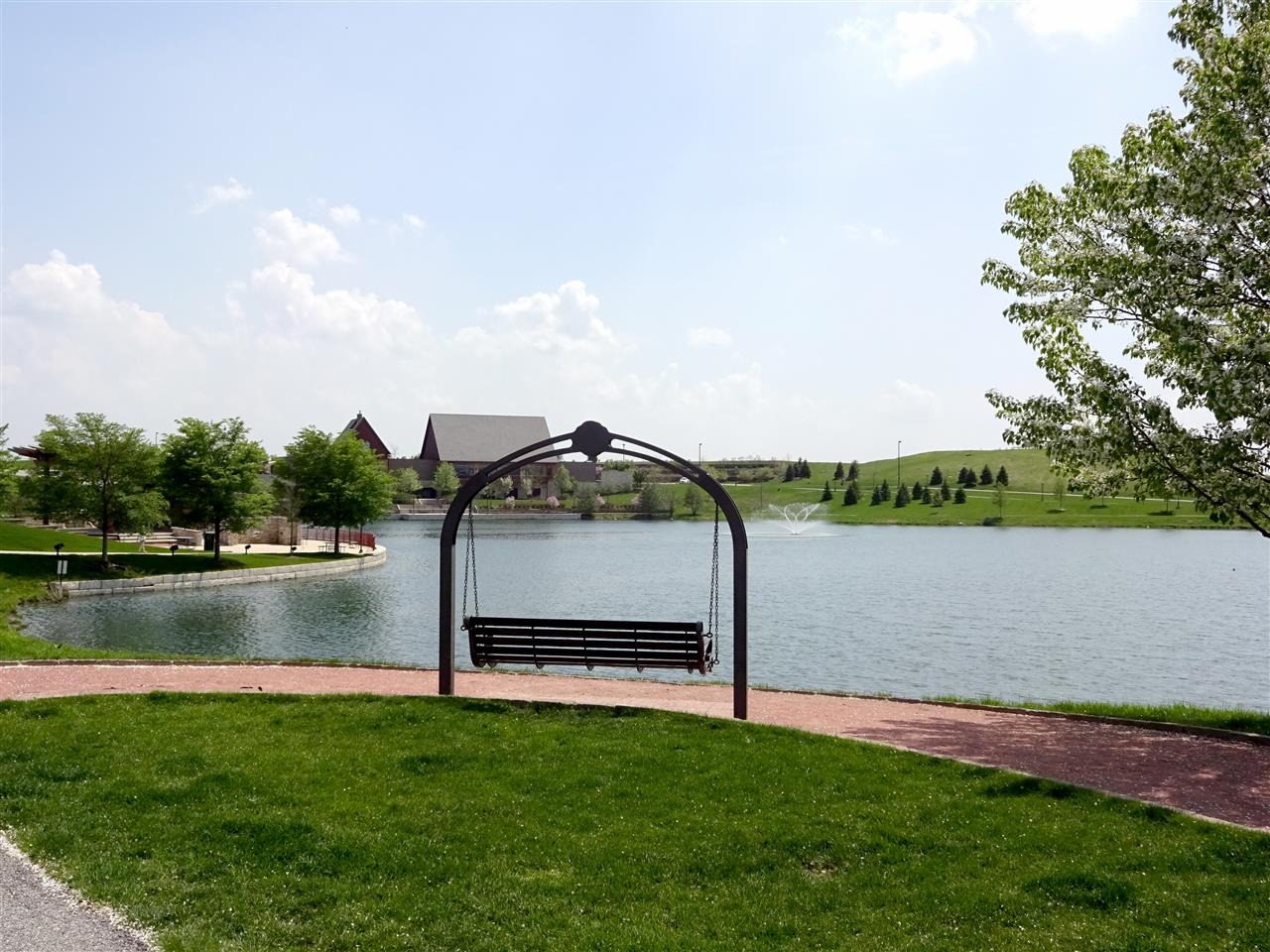 Swing overlooking the fishing pond and event facility at Centennial Park in Munster, Indiana.