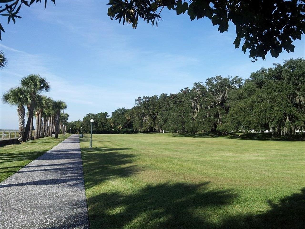 Waterfront sidewalk and lawns from the Jekyll Island Club Hotel.