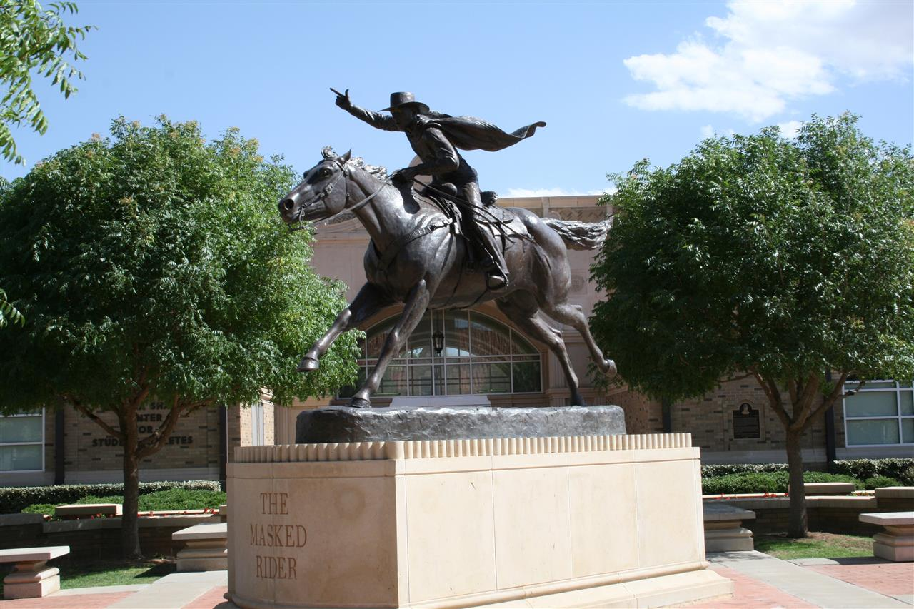 Memorializing one of the most cherished traditions of Texas Tech, the statue of the Red Raider's Masked Rider is near the Frazier Alumni Pavilion on the campus