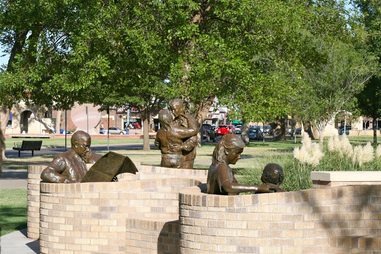 In her work called Park Place on the Texas Tech campus, sculptures by Glenna Goodacre beautifully depict ordinary activities in an extraordinary way.