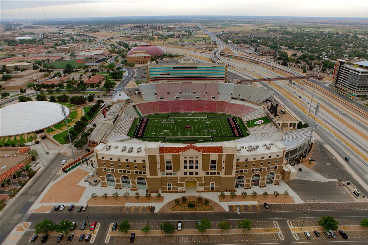 Aerial photo of AT&T Jones Stadium on the Texas Tech University campus.  The newly opened Marsha Sharp Freeway runs along the north side of the campus.