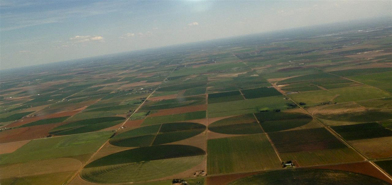 Aerial view of West Texas near Lubbock--cultivated acres and center pivots irrigation systems create patchwork landscapes. Lubbock and West Texas offer a diverse economy with agriculture as a foundation.