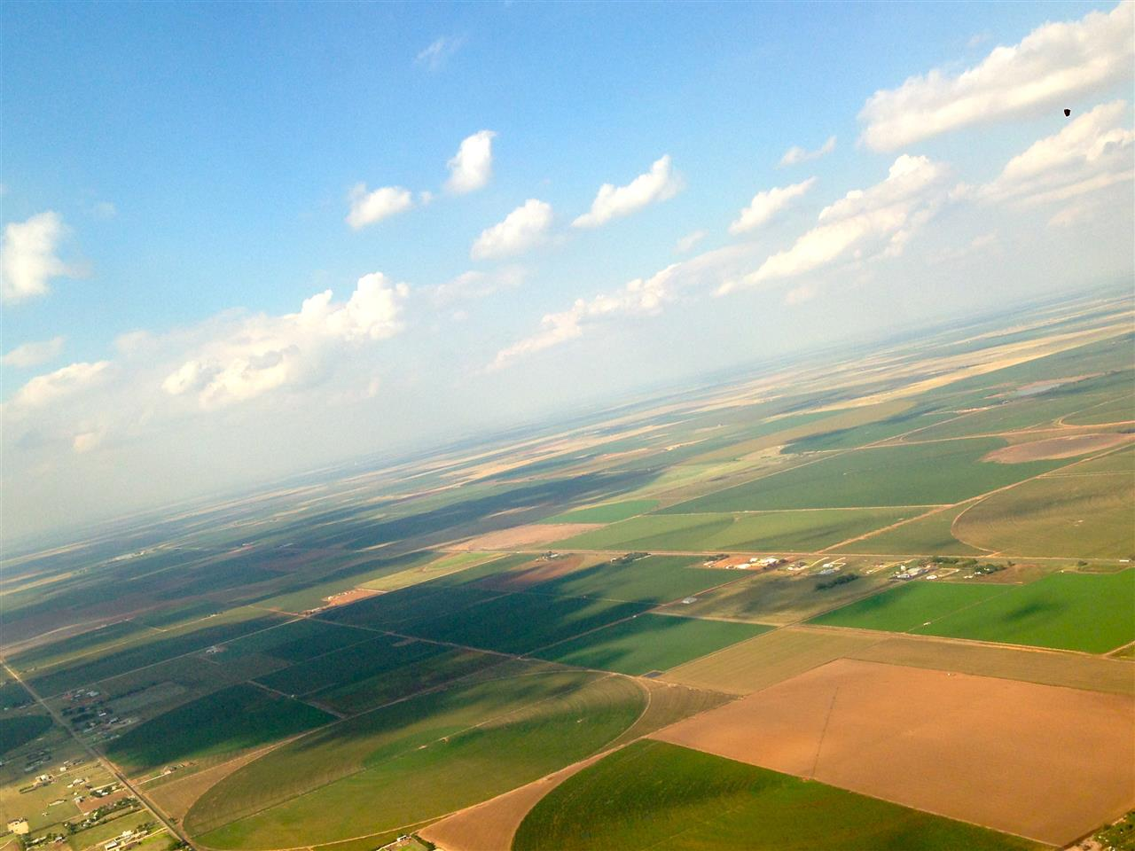 Wide open spaces--the land, the sky and an expansive horizon