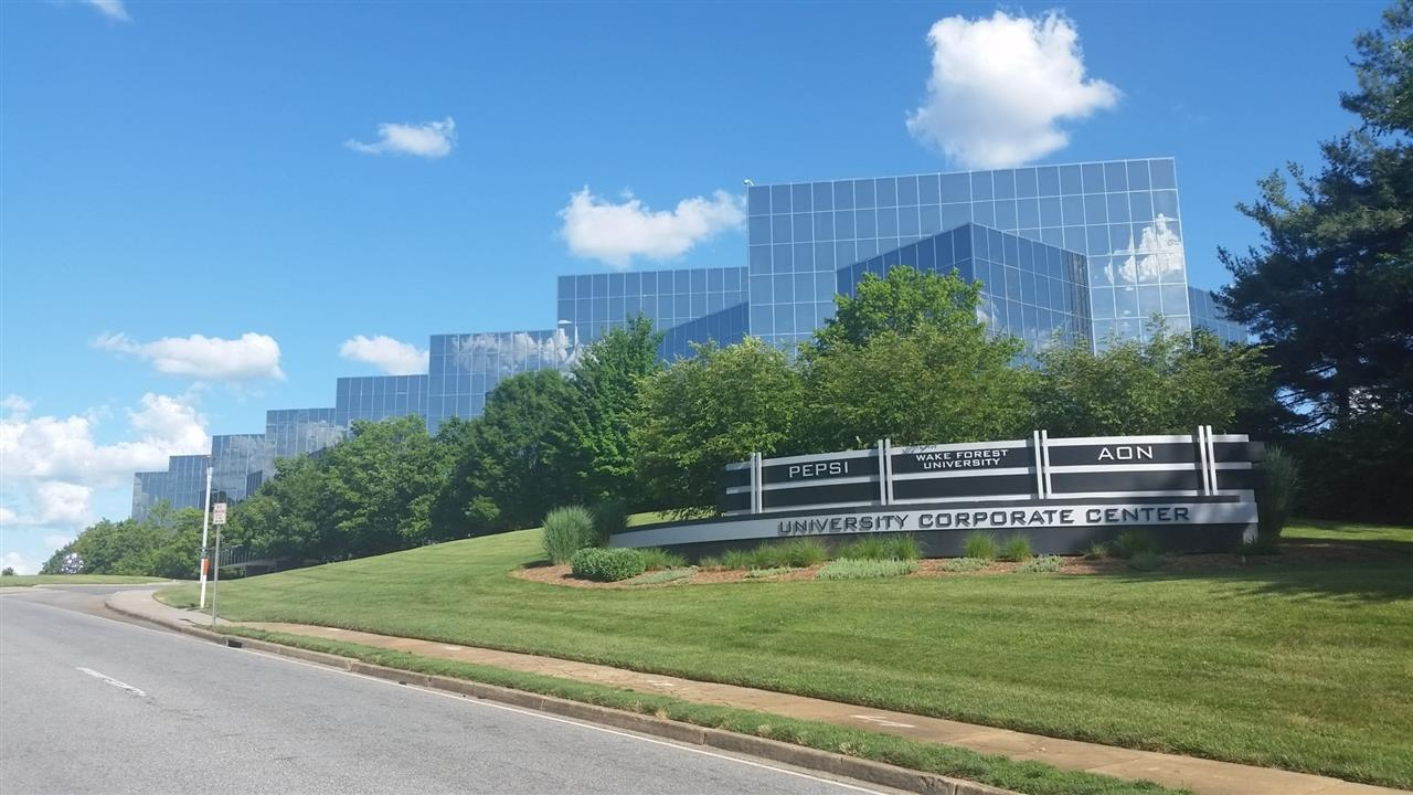 University Corportate Center sign with Bowman Gray Technology Building in the background from another angle