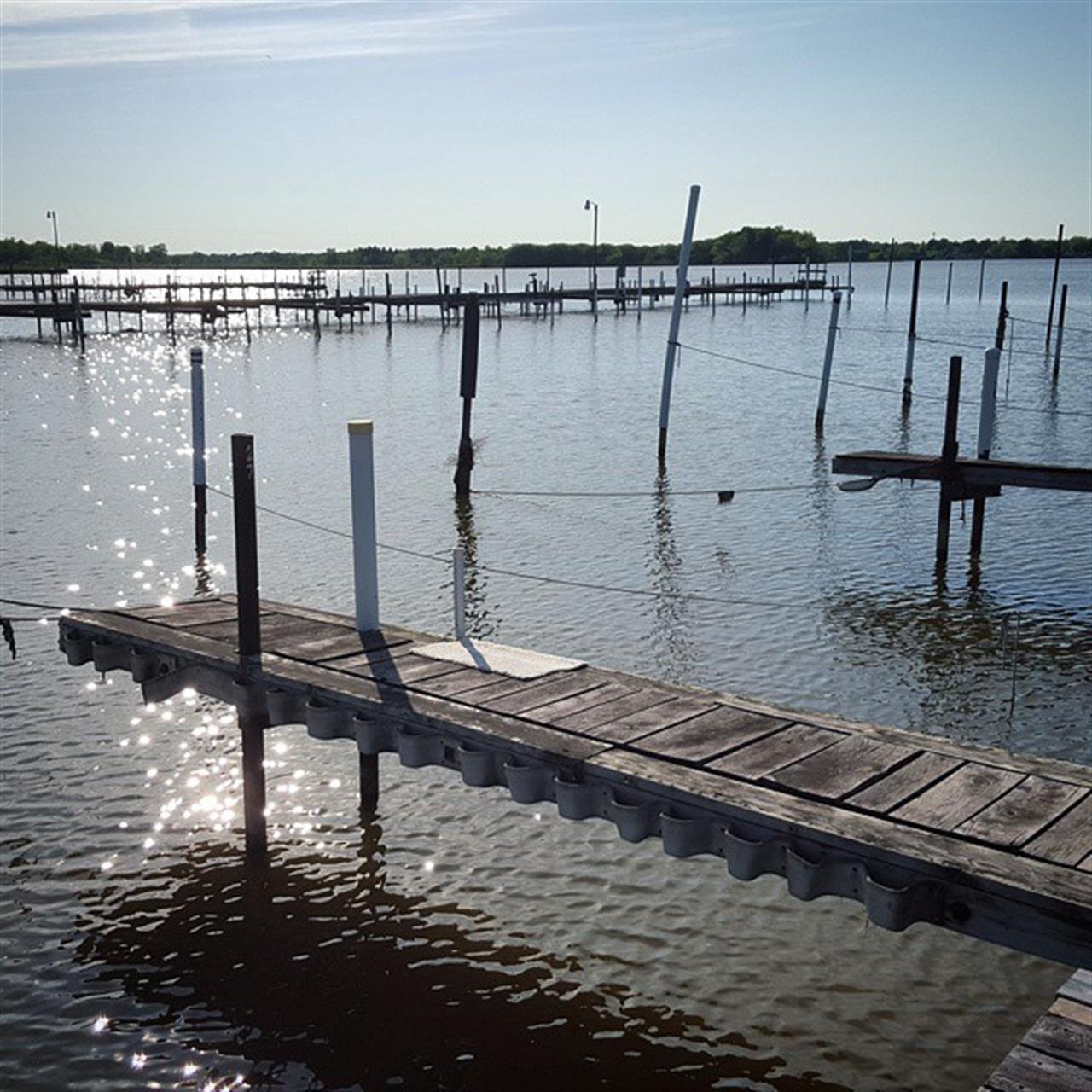 Walking on the docks at Braddock Bay in Rochester NY #dock #lake #water #blueskies #rochesterny #roctopshots #leadingrelocal #marina