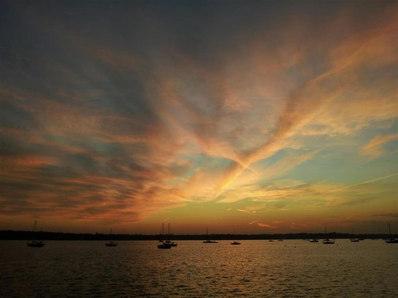 Sunset on Manhasset Bay overlooking Sands Point in Port Washington, NY.
