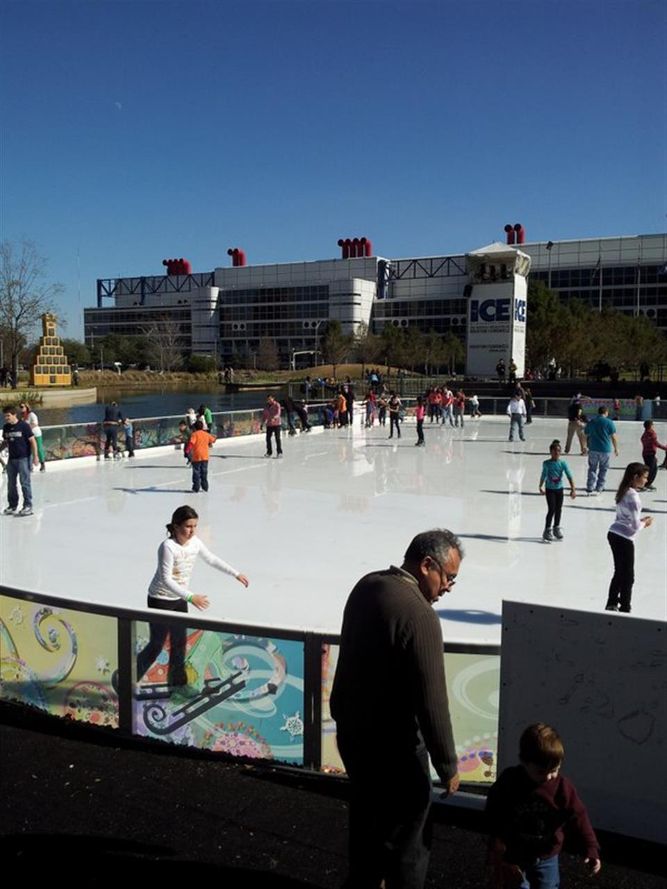 Ice skating Discovery Green in downtown Houston