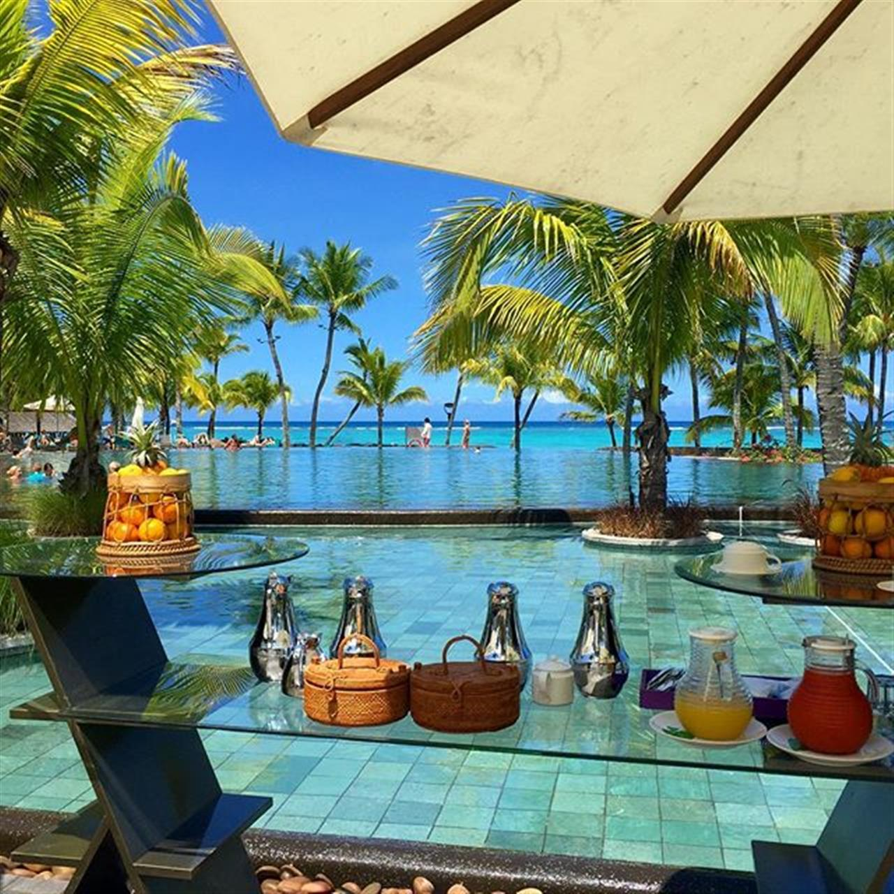 Inviting fruits and pool in #mauritius at the Trou Aux Biches Hotel #beachcomberhotels #leadingrelocal