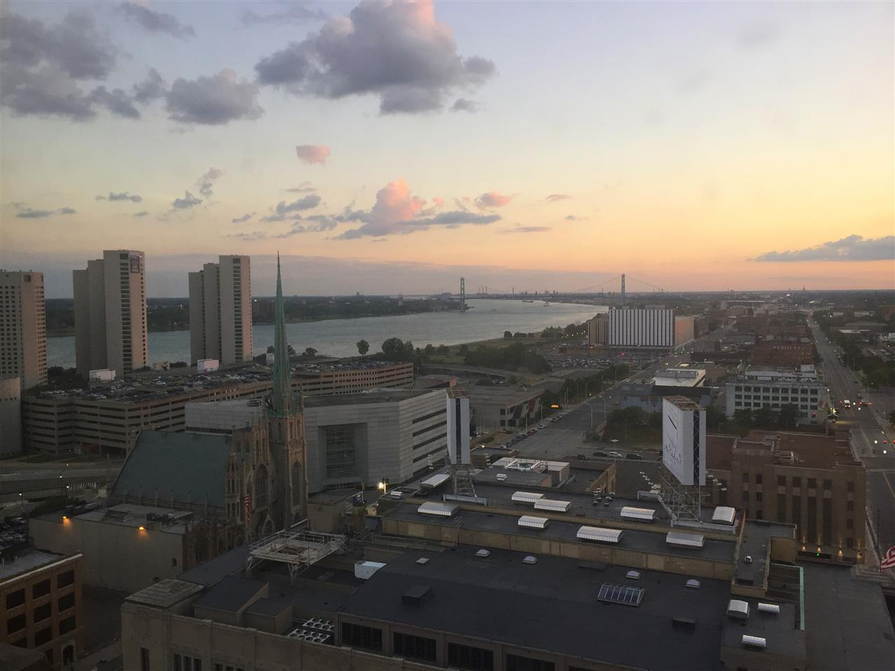 Expanse of Detroit, USA and Windsor, Canada and the Detroit River at sunset #Detroit #Michigan